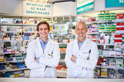 Buy stock photo Portrait of two male pharmacists working in a chemist