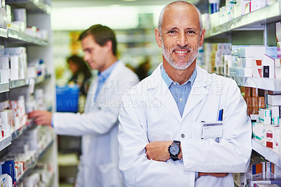 Buy stock photo Portrait of a confident mature pharmacist working in a pharmacy