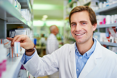 Buy stock photo Portrait of a young pharmacist doing inventory in a pharmacy