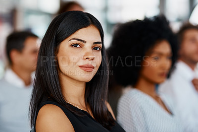 Buy stock photo Cropped portrait of an attractive young businesswoman sitting in the conference room during a seminar