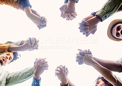 Buy stock photo Cropped shot of a group of friends holding hands