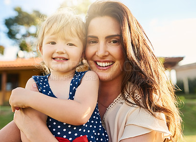 Buy stock photo Portrait of a mother bonding with her adorable little daughter outdoors