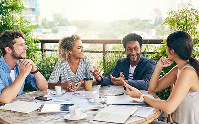 Buy stock photo Shot of a group of businesspeople having a meeting outdoors