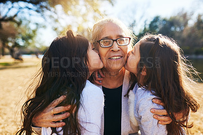 Buy stock photo Cropped shot of a grandmother getting kissed on the cheeks by her two adorable granddaughters