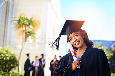 Buy stock photo Cropped shot of a happy young woman holding her certificate on graduation day