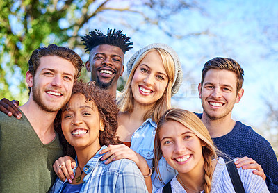 Buy stock photo Portrait of a group of diverse students hanging out together outside on campus