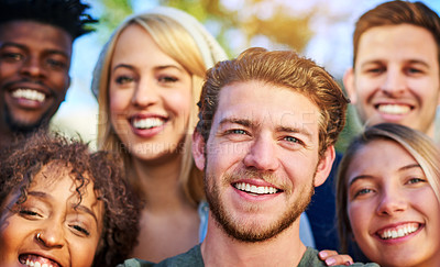 Buy stock photo Portrait of a group of students hanging out together outside on campus