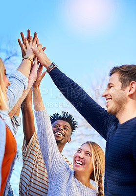 Buy stock photo Cropped shot of university students standing outside with their hands together