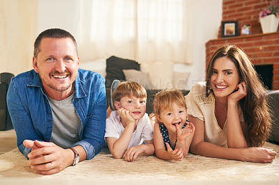 Buy stock photo Portrait of a happy young family spending quality time together at at home