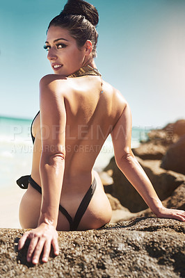 Buy stock photo Rearview shot of a beautiful young woman in her bathing suit at the beach