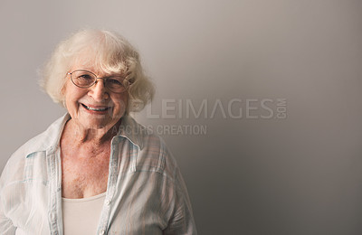 Buy stock photo Portrait of a happy senior woman against a gray background