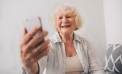 Buy stock photo Shot of a senior woman taking selfies on a mobile phone in a retirement home