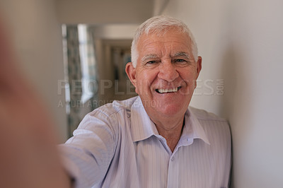 Buy stock photo Shot of a senior man taking selfies in a retirement home