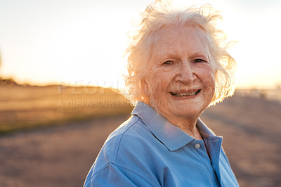 Buy stock photo Cropped shot of a senior woman standing outside