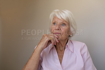 Buy stock photo Shot of a senior woman looking thoughtful in a retirement home