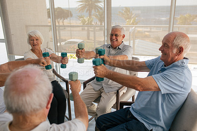 Buy stock photo Shot of a group of senior people working out with weights in a retirement home