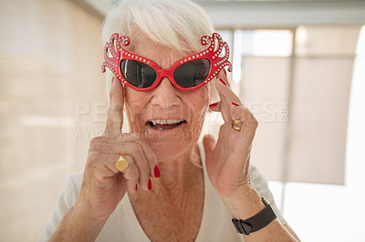 Buy stock photo Shot of a senior woman wearing funky sunglasses in a retirement home