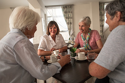 Buy stock photo Shot of a group of senior people having coffee together at a retirement home