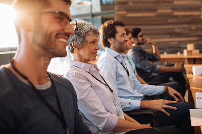 Buy stock photo Shot of a group of businesspeople listening to a presentation in an office