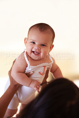 Buy stock photo Shot of a young woman bonding with her adorable baby girl at home