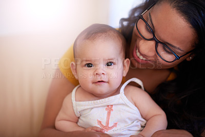 Buy stock photo Shot of a young woman relaxing on the sofa with her adorable baby girl at home