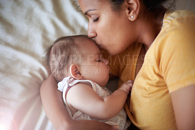 Buy stock photo Shot of an adorable baby girl sleeping peacefully in her mother's arms at home