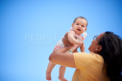 Buy stock photo Shot of a young woman having fun with her adorable baby girl outdoors
