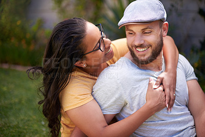 Buy stock photo Shot of a happy young couple spending time together in a garden