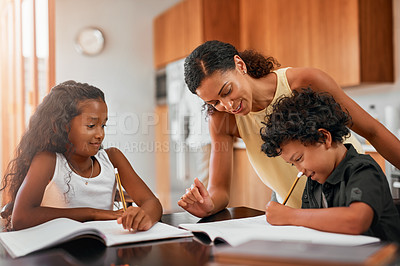 Buy stock photo Shot of a dad helping his children with their homework