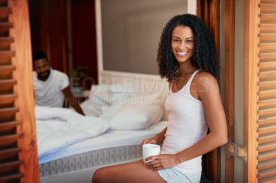 Buy stock photo Cropped shot of beautiful young wife drinking a cup of coffee while her handsome husband is sitting in bed at home