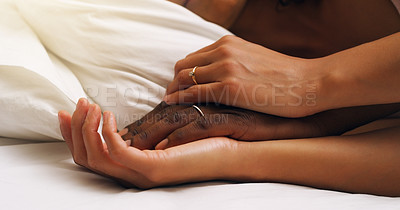 Buy stock photo Closeup shot of an unrecognizable couple sleeping in bed at home