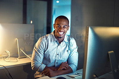 Buy stock photo Portrait of a young businessman working late on a computer in an office