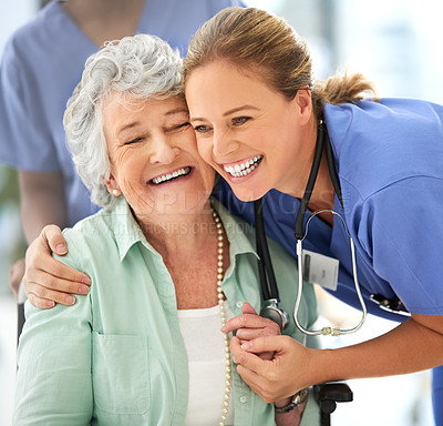Buy stock photo Cropped shot of an attractive female nurse and her senior patient in the hospital