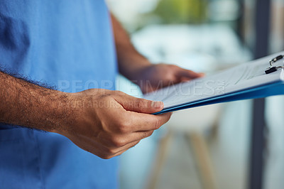 Buy stock photo Closeup shot of an unrecognizable medical practitioner holding a clipboard in a hospital