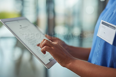 Buy stock photo Closeup shot of an unrecognizable nurse using a digital tablet in a hospital