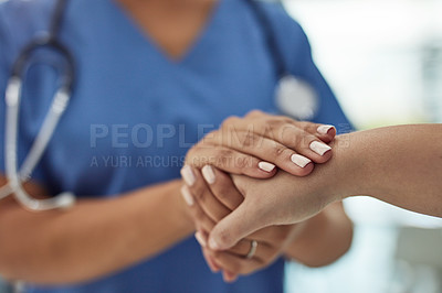 Buy stock photo Closeup shot of a nurse holding a patient's hand in comfort in a hospital