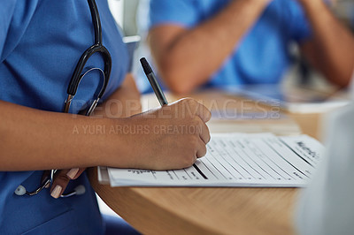 Buy stock photo Closeup shot of an unrecognizable medical practitioner writing on a clipboard with a nutritional facts table on it