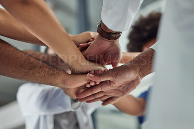 Buy stock photo Closeup shot of an unrecognizable group of medical practitioners putting their hands together in a huddle