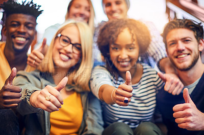 Buy stock photo Portrait of a group of diverse university students showing a thumbs up while sitting on the staircase on campus