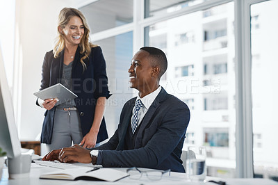 Buy stock photo Shot of two businesspeople working together in an office