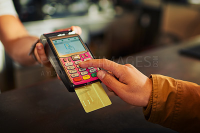 Buy stock photo Closeup of an unrecognizable person paying their bill with a card machine inside of a restaurant during the day