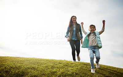 Buy stock photo Shot of an attractive young woman and her daughter in the park