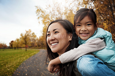 Buy stock photo Shot of a mother bonding with her little daughter outdoors