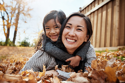 Buy stock photo Portrait of an adorable little girl enjoying an autumn day outdoors