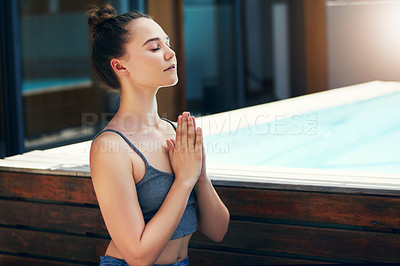 Buy stock photo Cropped shot of a beautiful young woman practicing yoga outside