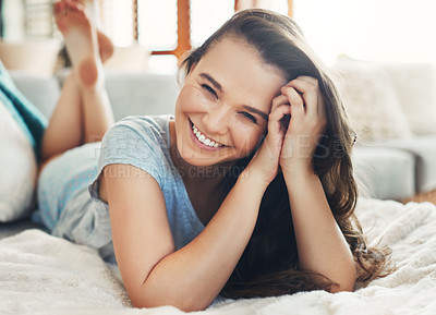 Buy stock photo Portrait of an attractive young woman spending a relaxing day on her bed at home