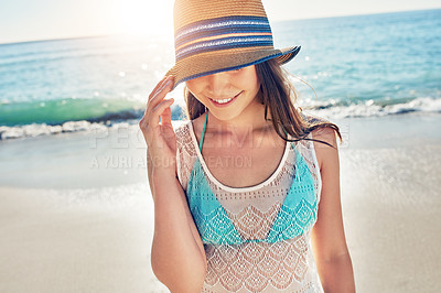 Buy stock photo Cropped shot of a beautiful young woman spending the day at the beach