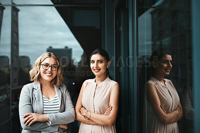 Buy stock photo Portrait of two young businesswoman standing on the office balcony