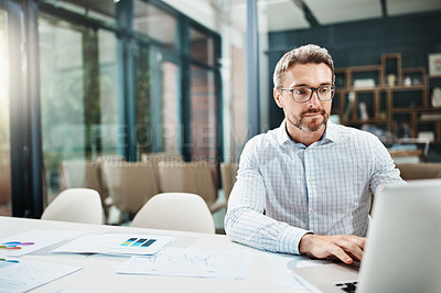 Buy stock photo Shot of a mature businessman working in an office
