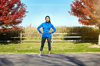 Buy stock photo Portrait of a sporty young woman standing outdoors